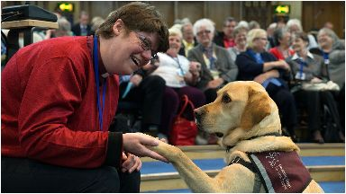Companian: Rev Mary Whittaker with her hearing dog.