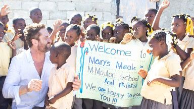 Haiti: Gerard Butler visited with Mary's Meals.