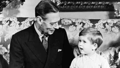 Family: King George VI, pictured with his grandson, Prince Charles.