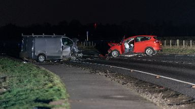 A car and a van involved in the crash.