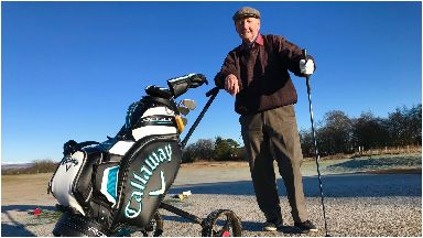 Young at heart: War veteran Les with his golf clubs.
