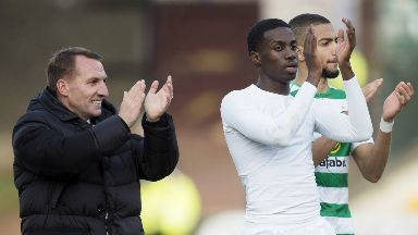 Rodgers applauds the Celtic support with striker Tim Weah.