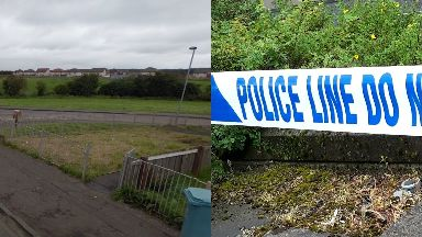 Newmains: Police cordoned off woods.