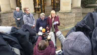 Julie's family speak outside court on Friday.