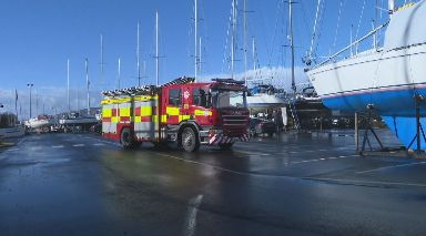 Fire: Crews were called to the marina in the early hours of Sunday morning.