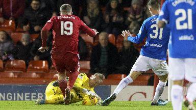 Challenge: McGregor catches Ferguson on the shin.