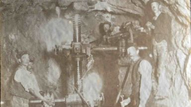 Workers with a tunnelling machine.