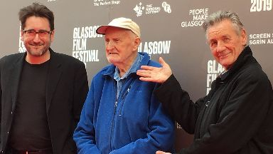 Glasgow: Robbie Fraser, Hamish MacInnes and Sir Michael Palin.