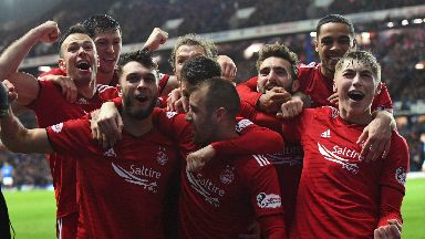 Aberdeen players celebrate their second goal.