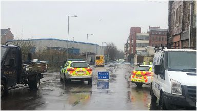Burned: A woman has died after being found on wasteground.