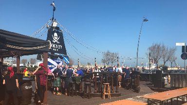 Scotland fans soak up the sun before tomorrow's match.