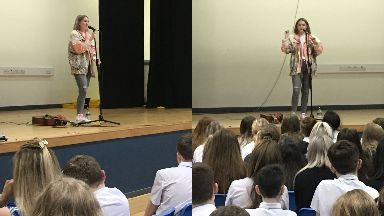 Dundee: The singer performed for pupils.