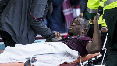 Treatment: Uche Ikpeazu is stretchered round the field after suffering a head knock
