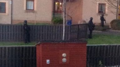Gorebridge: Police surrounded the block of flats.