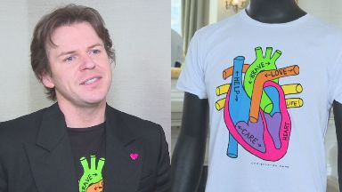 Support: Christopher Kane has designed t-shirts and badges.