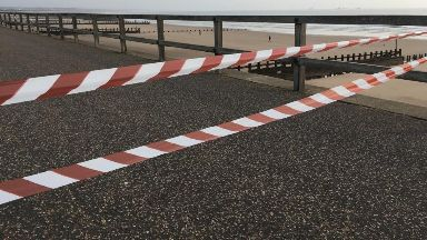 Death: A stretch of the beach has been cordoned off.