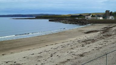 Thurso beach: The woman was cut free after two hours.