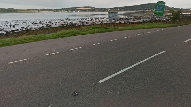 Crash: Three men swam to safety.