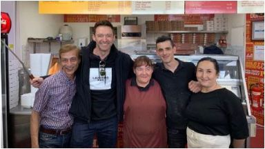 Delighted: Hugh sampled a 'pizza crunch' at a chip shop in Clydebank.