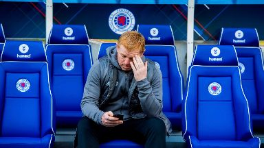 Dejected: Neil Lennon after the Old Firm defeat at Ibrox.