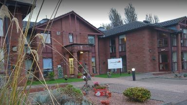 Lomond Court: Staff found the man in pain.