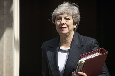 Theresa May: Leaving for Prime Minister's Questions on Wednesday.