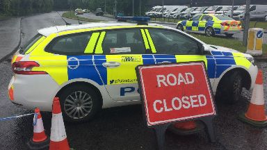 Police: Officers have closed the road.