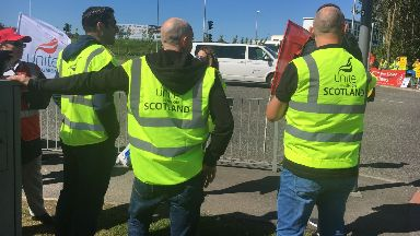 Aberdeen: Workers striking outside the airport.