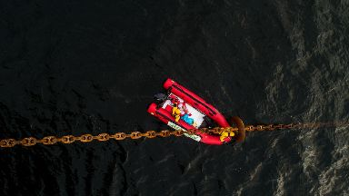 Greenpeace: Campaigners pulled up in a boat.