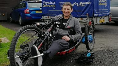 Stuart enjoys hobbies such as hand cycling despite his paralysis.