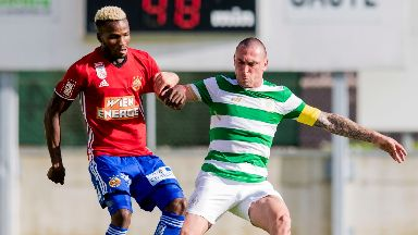 Boli Bolingoli-Mbombo does battle with Celtic captain Scott Brown during a 2017 friendly.