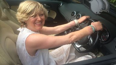 Raring to go: Ms Hutton behind the wheel of her car with her new hands.