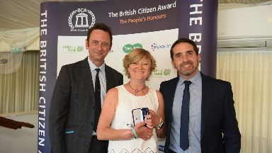 Medal: Corinne Hutton with event host Matt Allwright and Jonny McQuarrie.