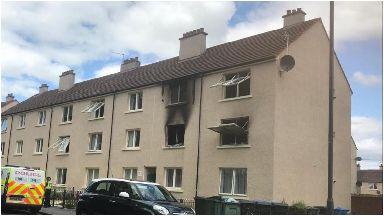 Fire: Man dead after flat blaze.