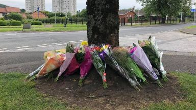 Tributes: Flowers were left at the scene of the crash.