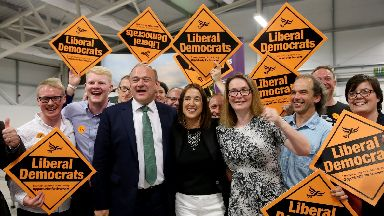 Lib Dems celebrate their by-election victory.