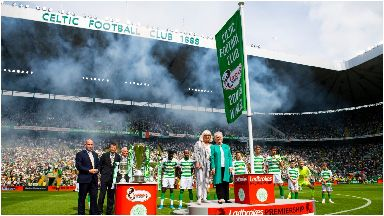 Champions: Sadie Chalmers and Liz McNeill unfurled the league flag.