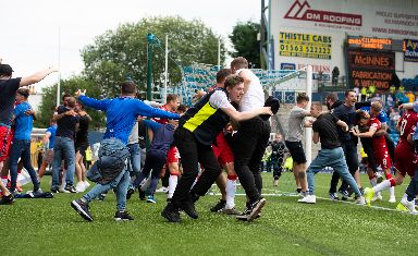 Pitch invasion: After a later Rangers winner.
