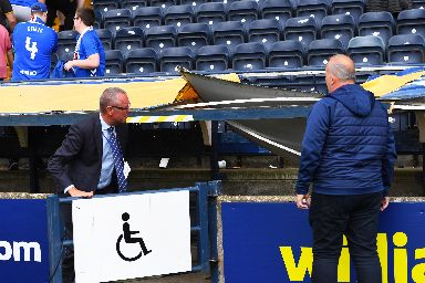 Disabled section: Officials assessing the damage caused.