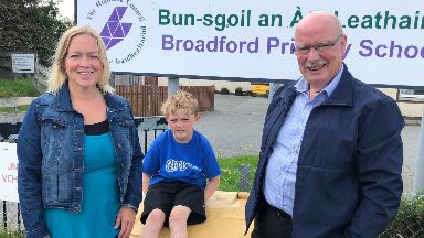 Concerned: Tansy Grigor-Taylor and son Archie with Broadford Community School Working Group chairman Hamish Fraser.