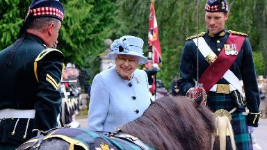 Balmoral: The Queen was greeted by the Royal Regiment of Scotland.