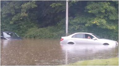 Flood: Car stuck near Edinburgh Airport.