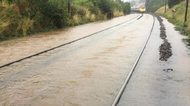 Disruption: The West Coast main line flooded.