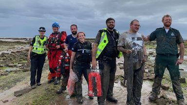 Heroes: The muddy rescuers with the Texan.