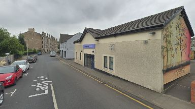 Paisley: The robber struck outside the Co-op Funeralcare building.