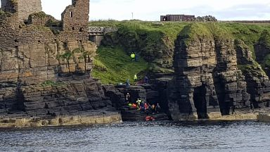 Rescue: The 14-year-old was trapped for almost three hours.