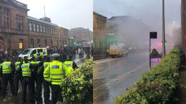 Riot: Protesters clashed with an Irish unity march.