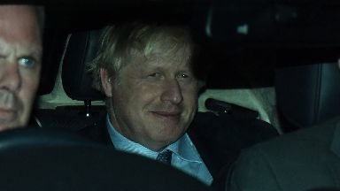 Boris Johnson leaves Westminster after losing his election motion.
