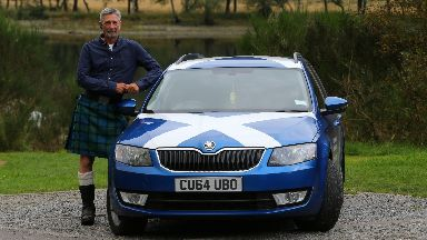 Kilted cabbie: Rob Jamieson has been told to remove the Saltires.