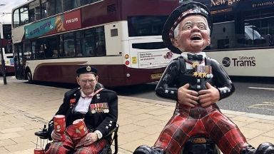 Tom Gilzean and his statue on Princes Street.